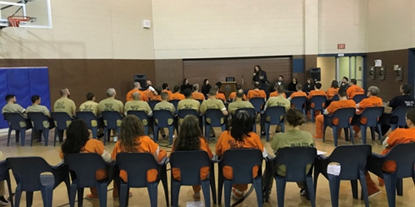 Brian Welch speaking to inmates